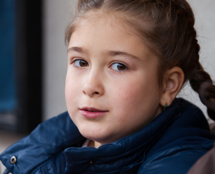 a cute child girl photographed near a Catholic chapel in November 2013, picture 2/2