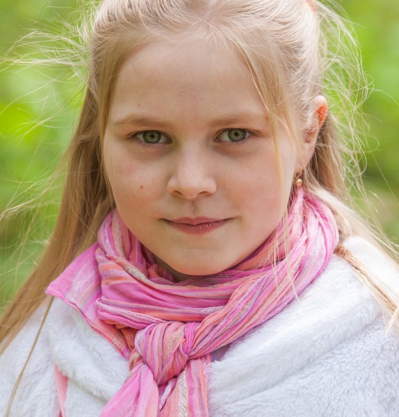 a cute Roman-Catholic blond child girl photographed in April 2014, portrait 3/29