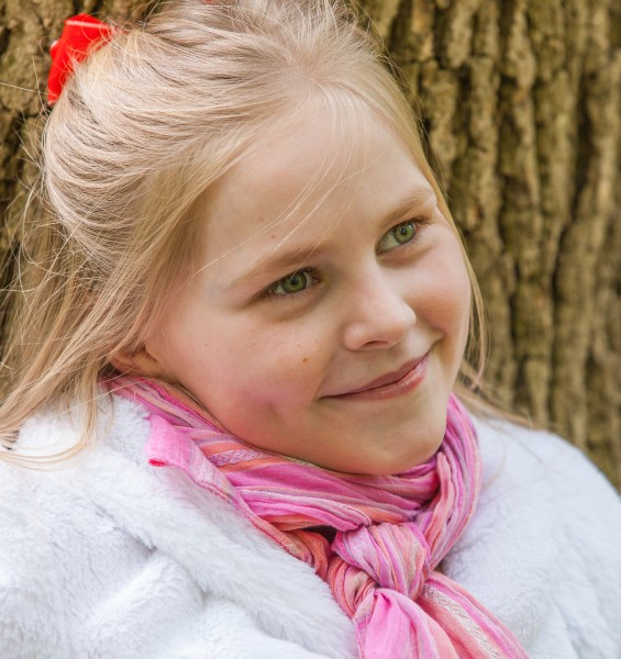 a cute Roman-Catholic blond child girl photographed in April 2014, portrait 20/29