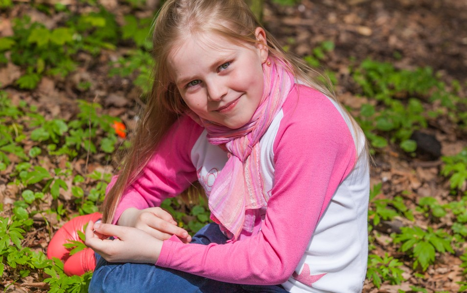 a cute Roman-Catholic blond child girl photographed in April 2014, portrait 22/29
