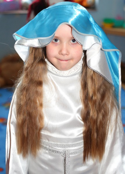 a girl playing the role of the Virgin Mary in the Nativity scene