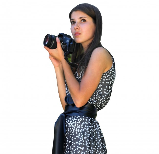 a marvelously beautiful Catholic girl holding a Canon DSLR camera in June 2013, cropped version