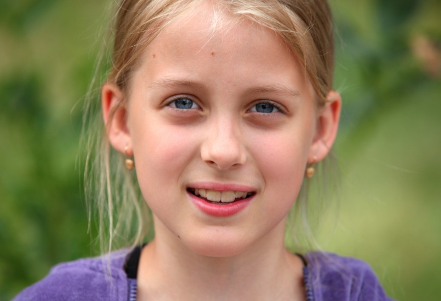a beautiful sweet blond young Roman-Catholic girl in a Christian camp in July 2013, portrait 3/5