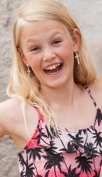 a blond pretty girl photographed in Uppsala, Sweden in June 2014, picture 6/34