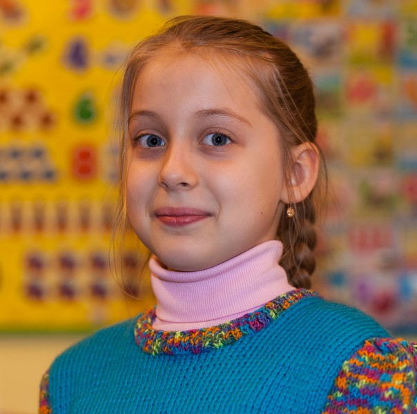 a young Catholic fair-haired pretty girl photographed in March 2014, image 1/6