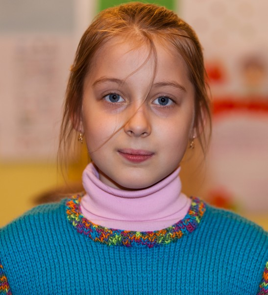 a young Catholic fair-haired pretty girl photographed in March 2014, image 2/6