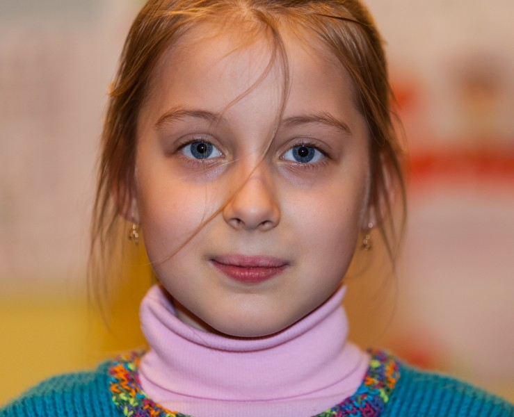 a young Catholic fair-haired pretty girl photographed in March 2014, image 4/6