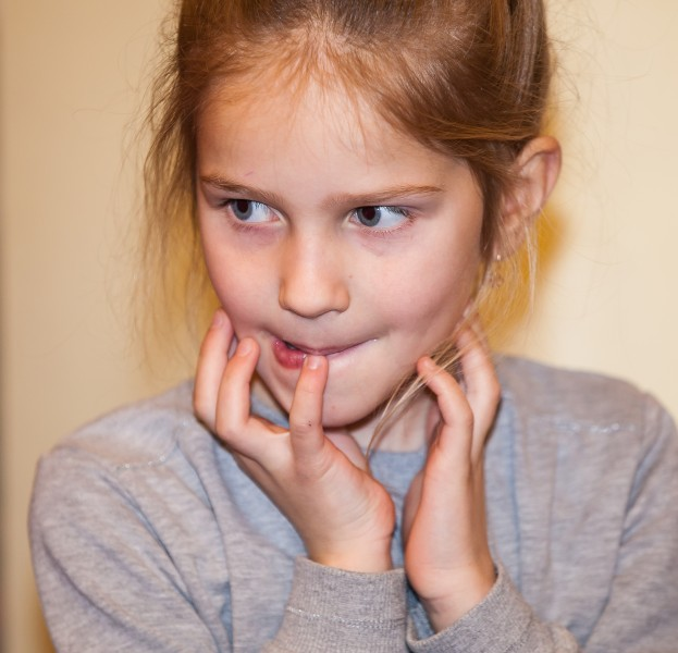 a young girl with an interesting face expression, photographed in December 2013