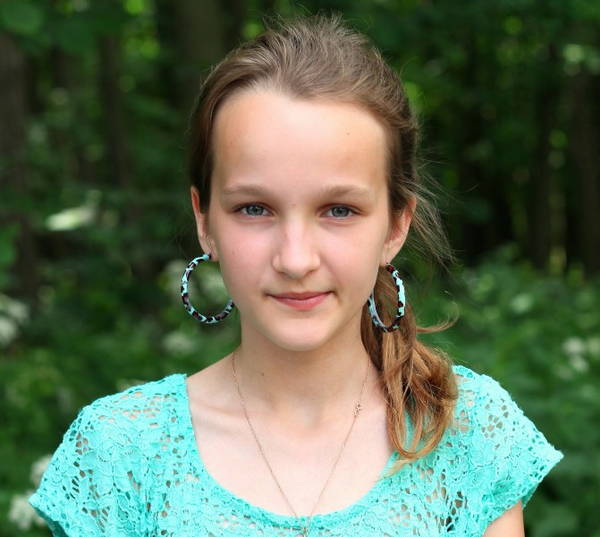 a charming beautiful girl with huge earrings, photographed in June 2013, portrait 14/27