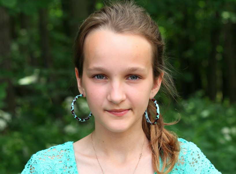 an absolutely beautiful girl with huge earrings, photographed in June 2013, portrait 15/27