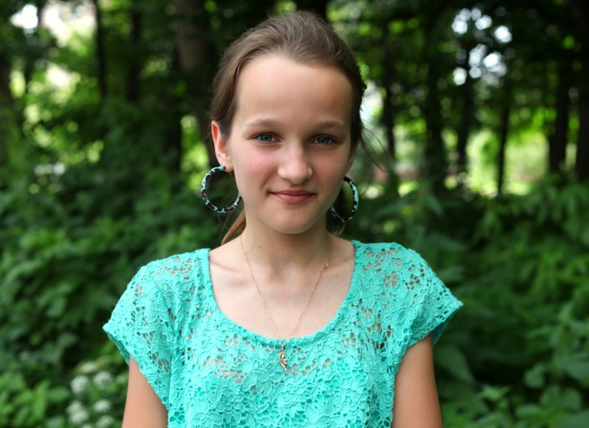 an absolutely beautiful girl with huge earrings, photographed in June 2013, portrait 22/27