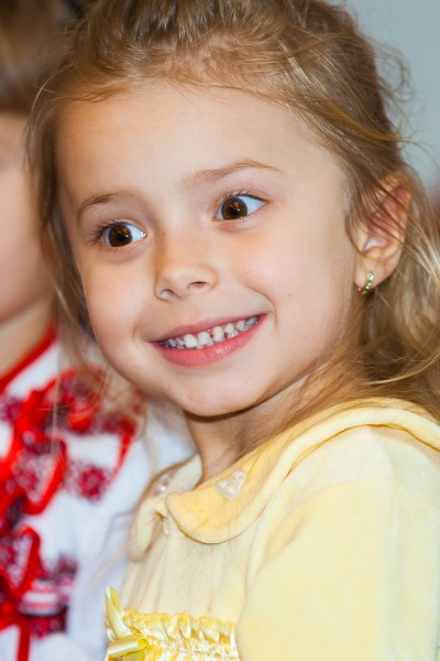 an amazing blond child girl in a Catholic kindergarten photographed in November 2013, picture 1