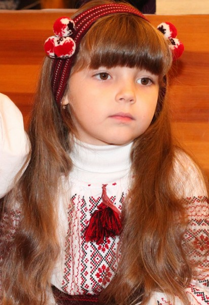 an amazingly beautiful brunette Catholic child girl in a Catholic kindergarten, photo 2