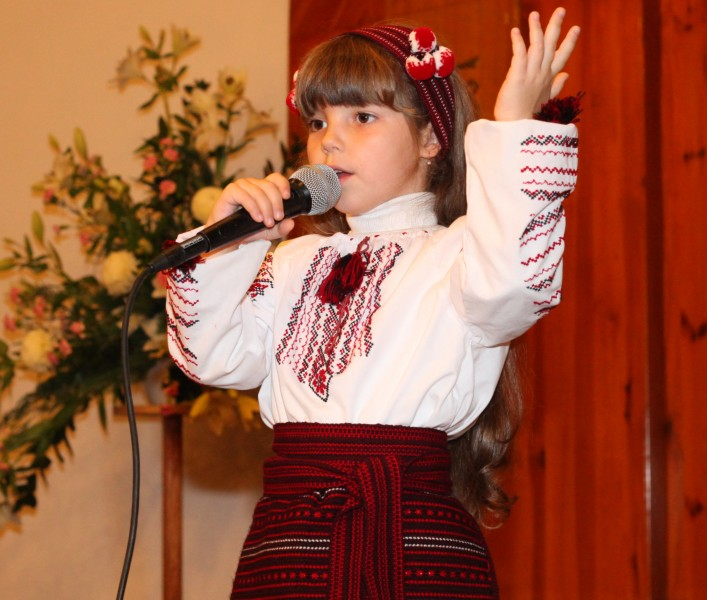 an amazingly cute brunette Catholic child girl performing in a Catholic kindergarten, photo 5
