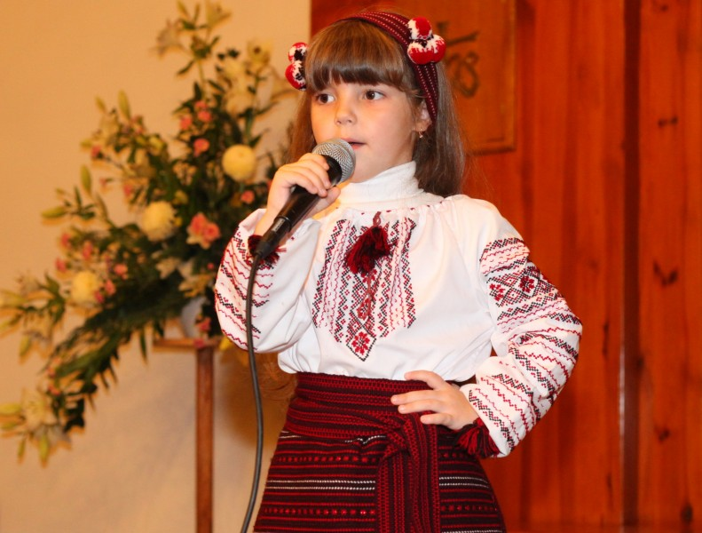 an amazingly cute brunette Catholic child girl performing in a Catholic kindergarten, photo 7