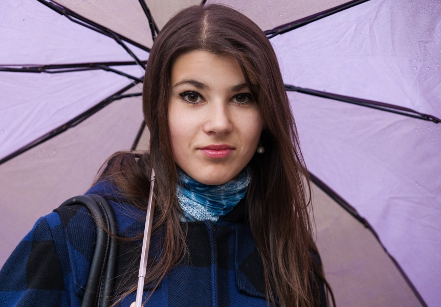 an exceptionally beautiful brunette Catholic girl holding an umbrella, photographed in November 2013, picture 1 out of 19