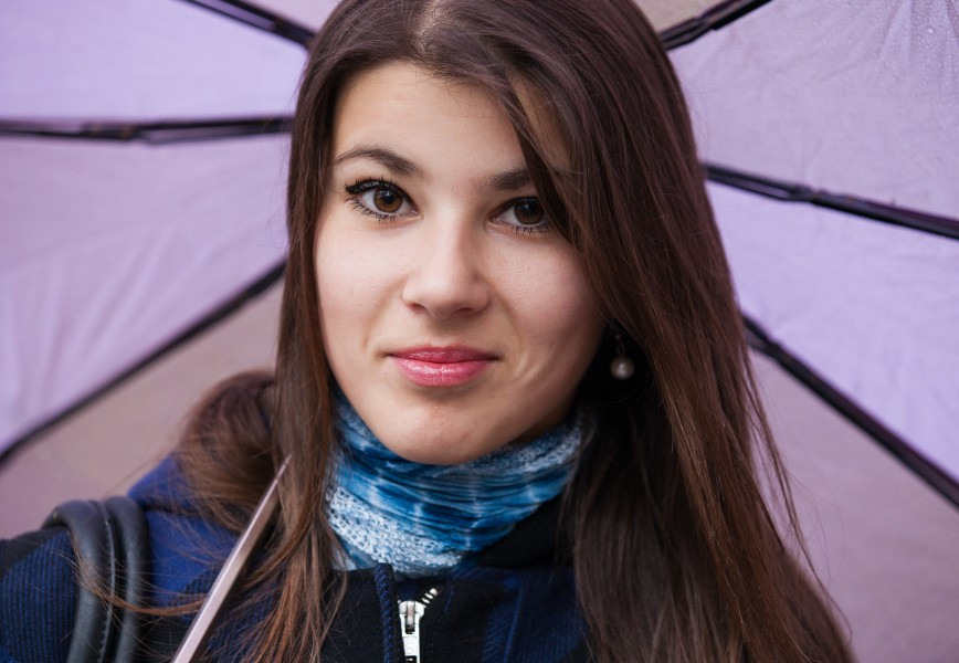 an exceptionally beautiful brunette Catholic girl with an umbrella photographed in November 2013, picture 2 out of 19