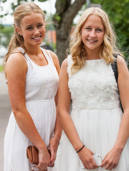 two beautiful blond girls wearing white dresses in Sigtuna, Sweden in June 2014, picture 2