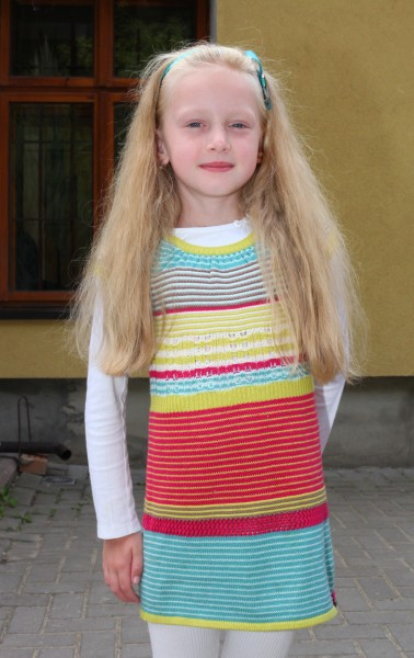 A beautiful blond Catholic child girl