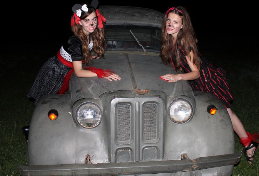 two fantastic charming beautiful brunette girls-animators in a Catholic camp on an ancient military car, photo 33
