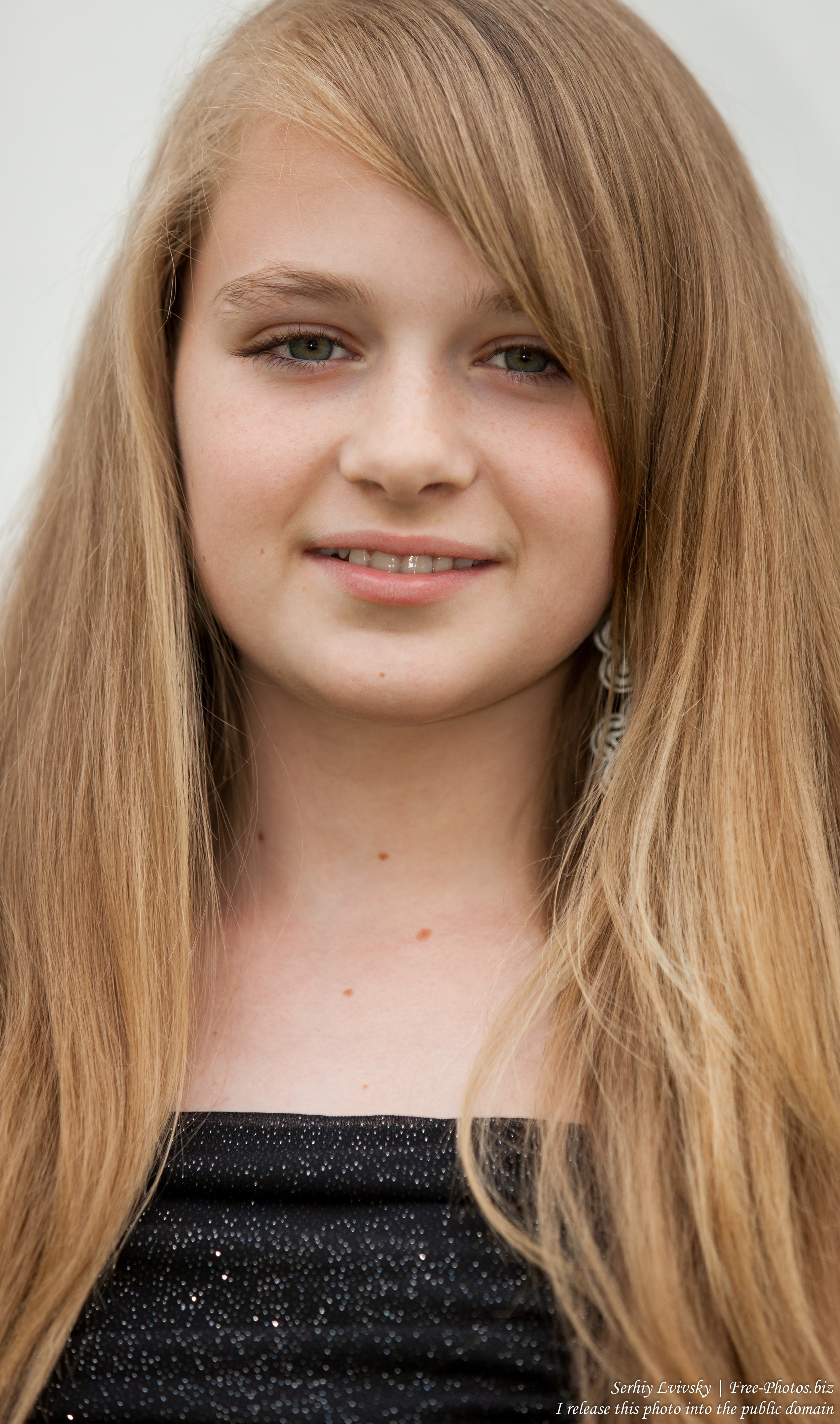a blond 13-year-old girl photographed in June 2015, picture 10