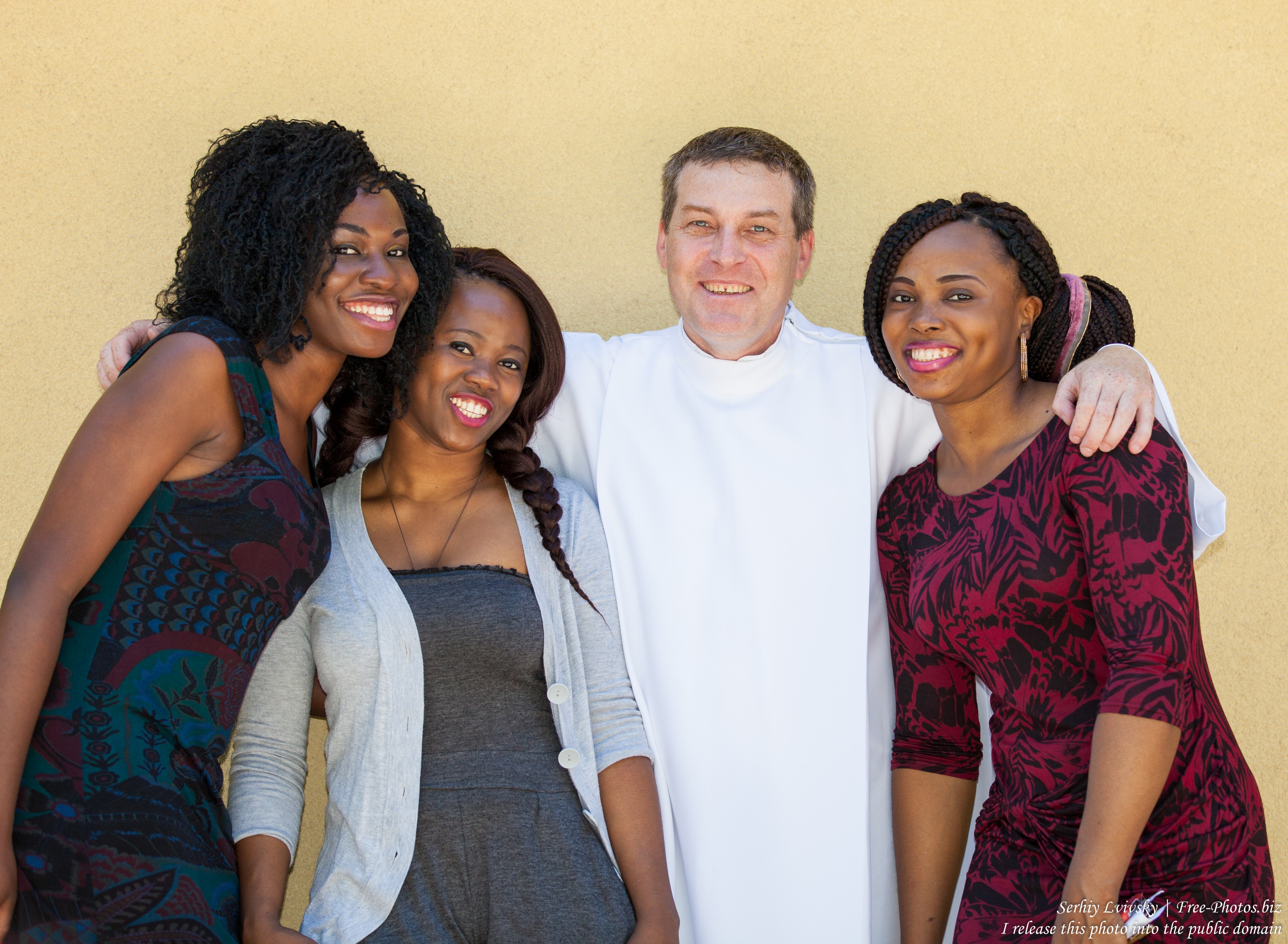 a Сatholic priest with his parishiners from Nigeria photographed in July 2015