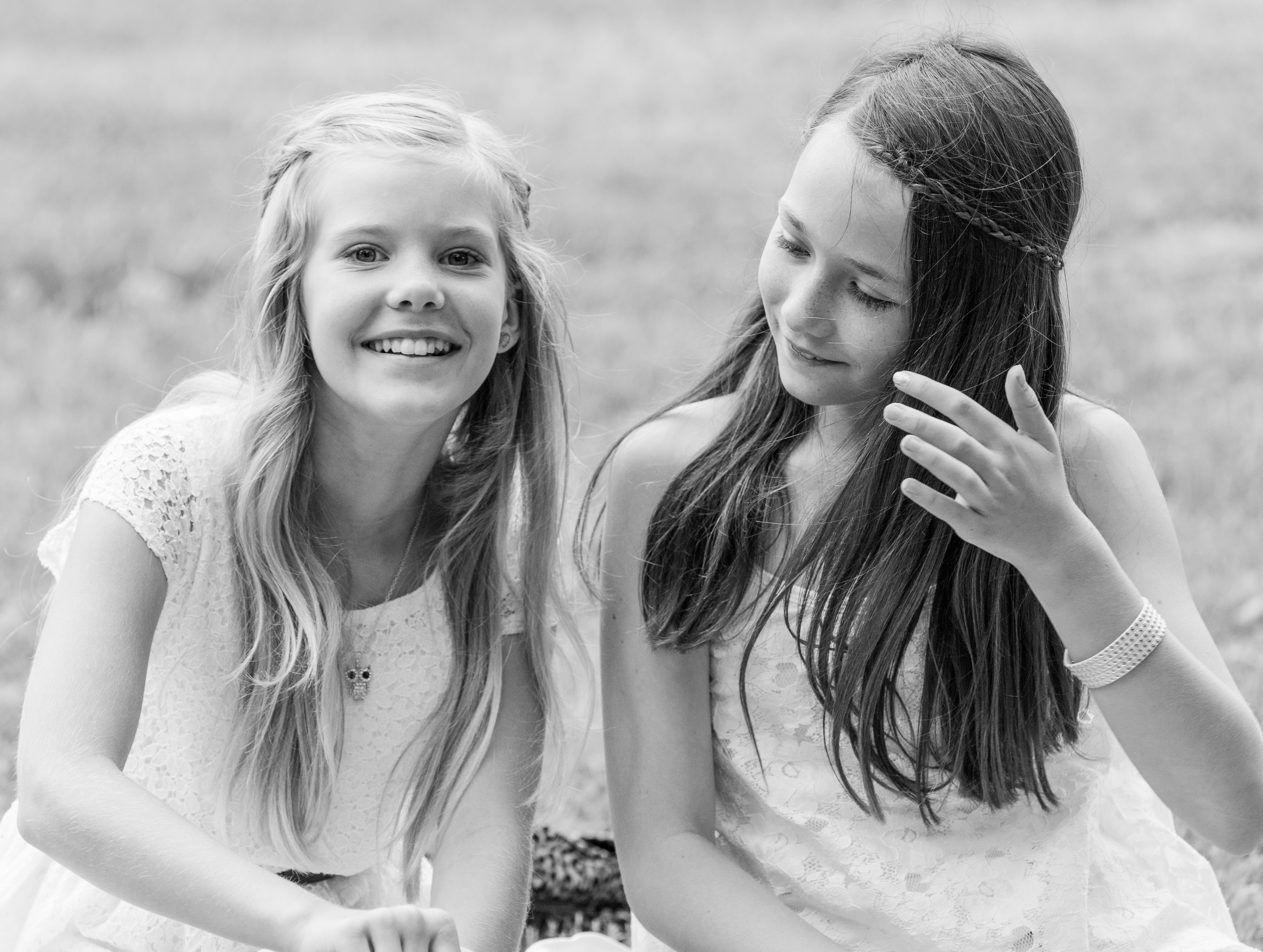 two cute girls in Sigtuna, Sweden in June 2014, picture 4 out 4, black and white version