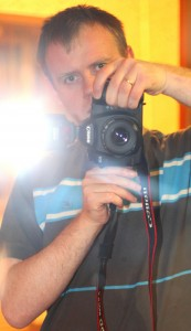 a young man taking picture of himself in the mirror