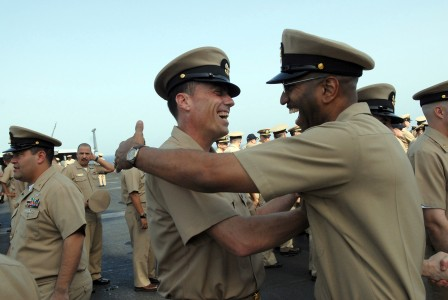 US Navy 080916-N-4005H-221 Newly pinned Chief Aviation Boatswain's Mate (Fuels) Robert Sparks is congratulated by a chief petty officer after a chief pinning ceremony aboard the aircraft carrier USS Ronald Reagan (CVN 76)