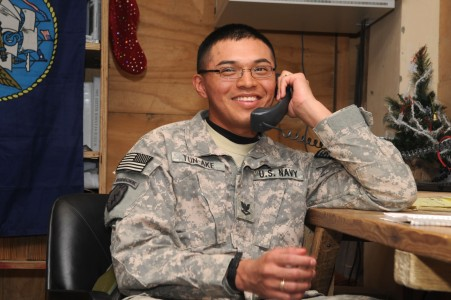 US Navy 091224-F-7418E-007 Petty Officer 3rd Class Luis Tun-Ake receives a surprise telephone call from President Barack Obama at Forward Operating Base Sharana, Afghanistan