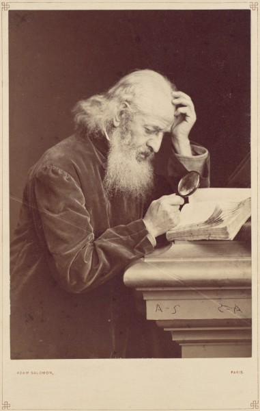 -Bearded Man with Magnifying Glass Examining a Manuscript- MET DP111349