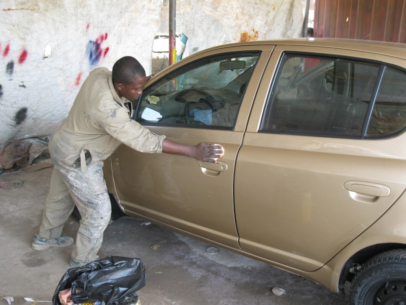 A Ghanaian Car paint sprayer
