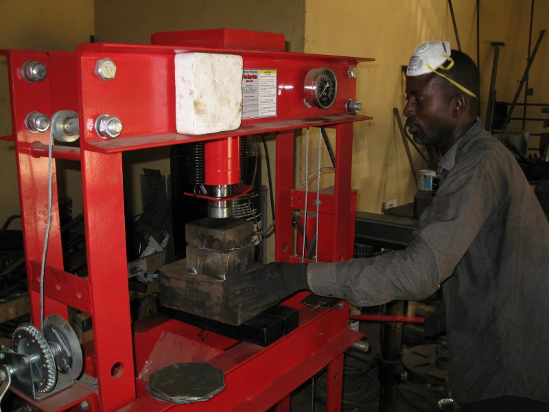 A Ghanaian Metal Fabricator at work