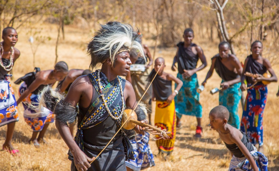 A Man from Gogo Tribe singing while palying Zeze with his tribe mate, Zeze is one of the famous Musical Instrumental In Tanzania