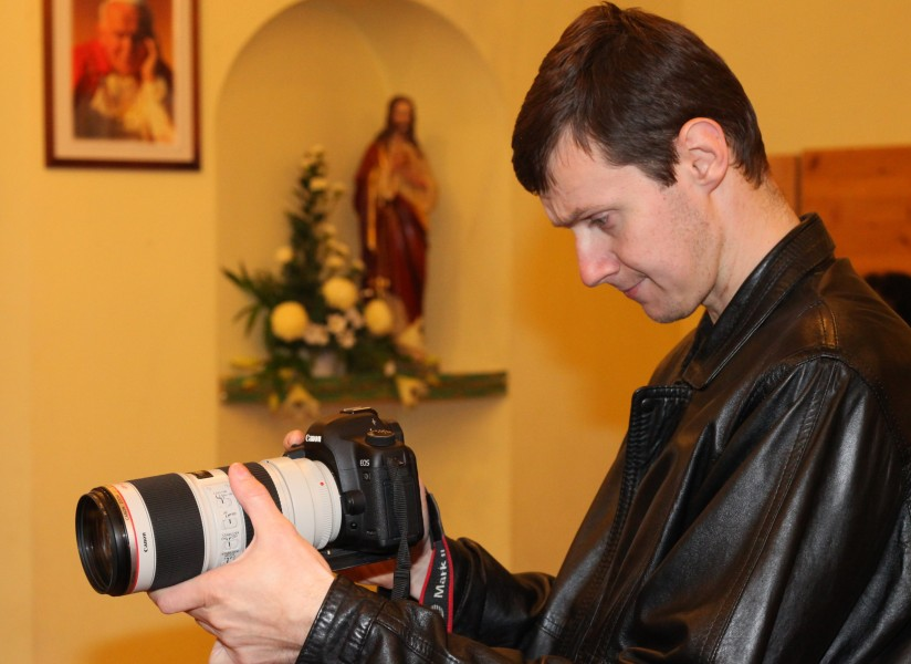 a man taking video in a Church with a Canon EOS 5D Mark II camera