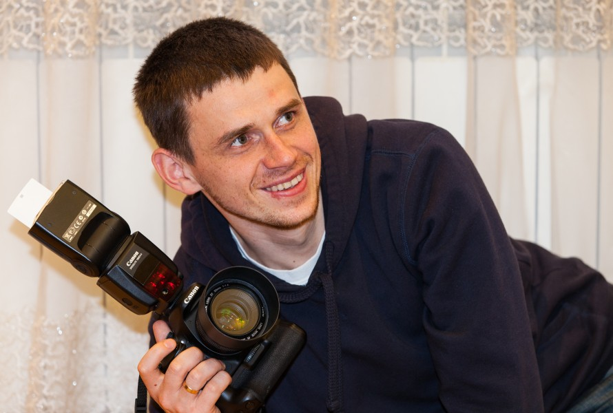 a photographer holding his Canon camera in April 2014