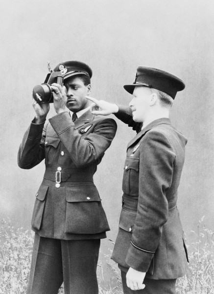 Pilot Officer J H Smythe of Sierra Leone, a newly-qualified navigator, being instructed in the use of the sextant by an instructor at No. 11 Operational Training Unit, Westcott in Buckinghamshire, 1 August 1943. CH10740