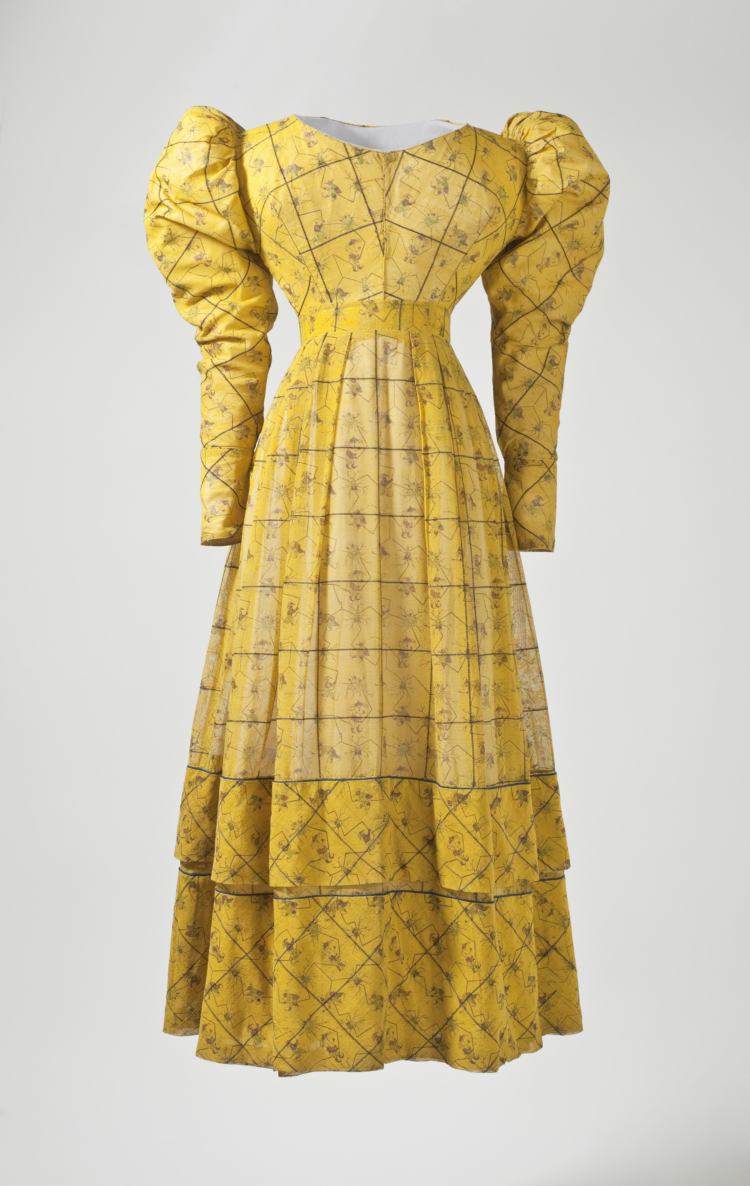 Woman's yellow print dress c. 1827