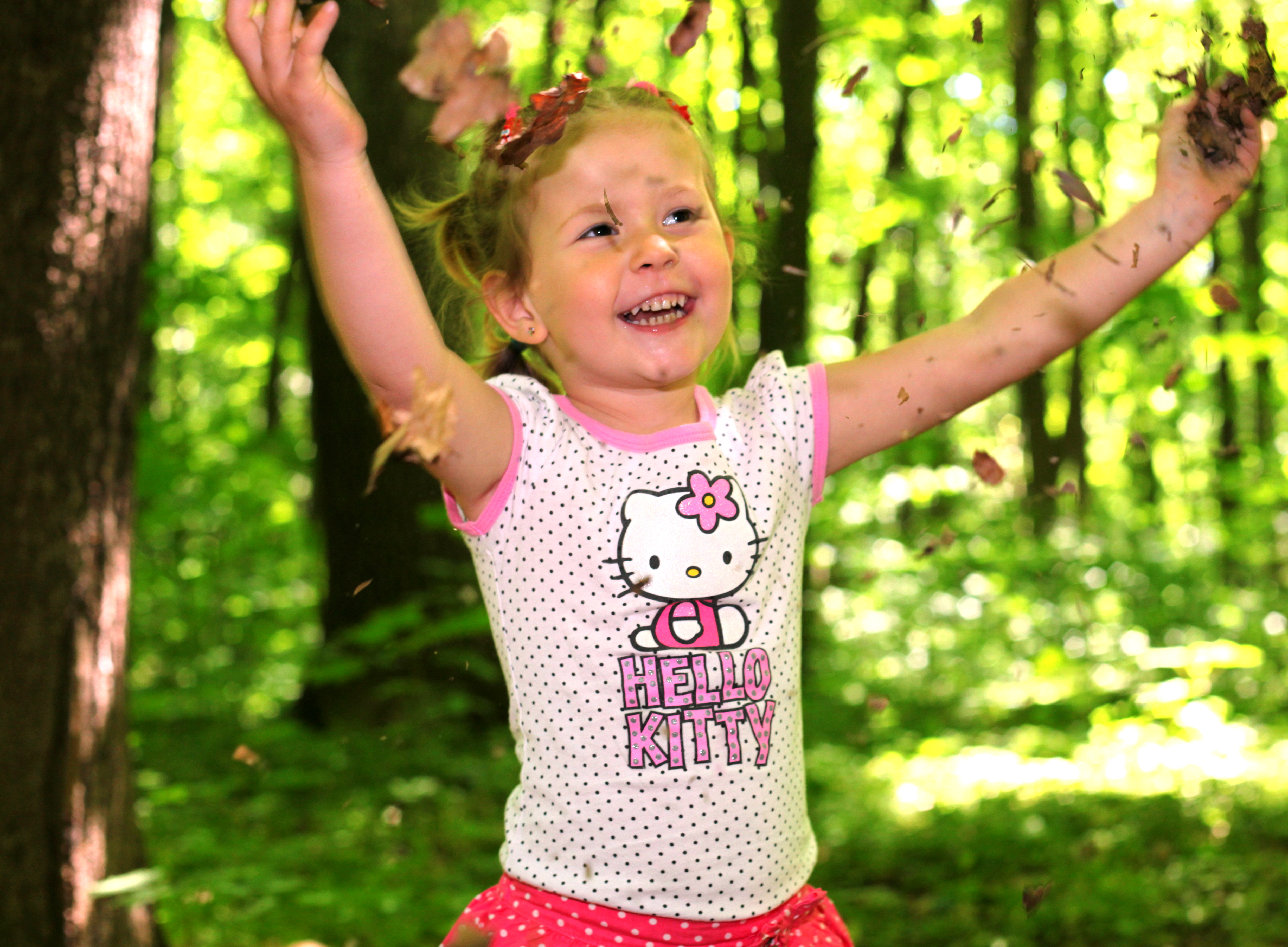 a cute Catholic kid girl in a forest photographed in May 2013, image 1/2