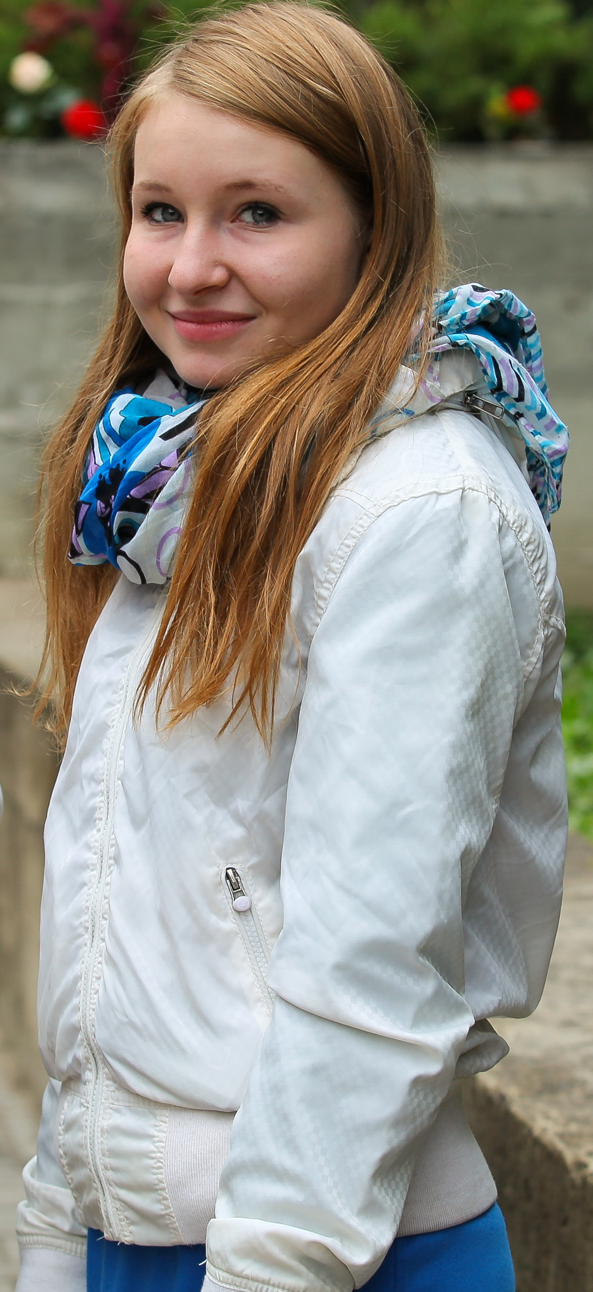 a cute blond girl near a Catholic church photographed in September 2013, picture 2/6
