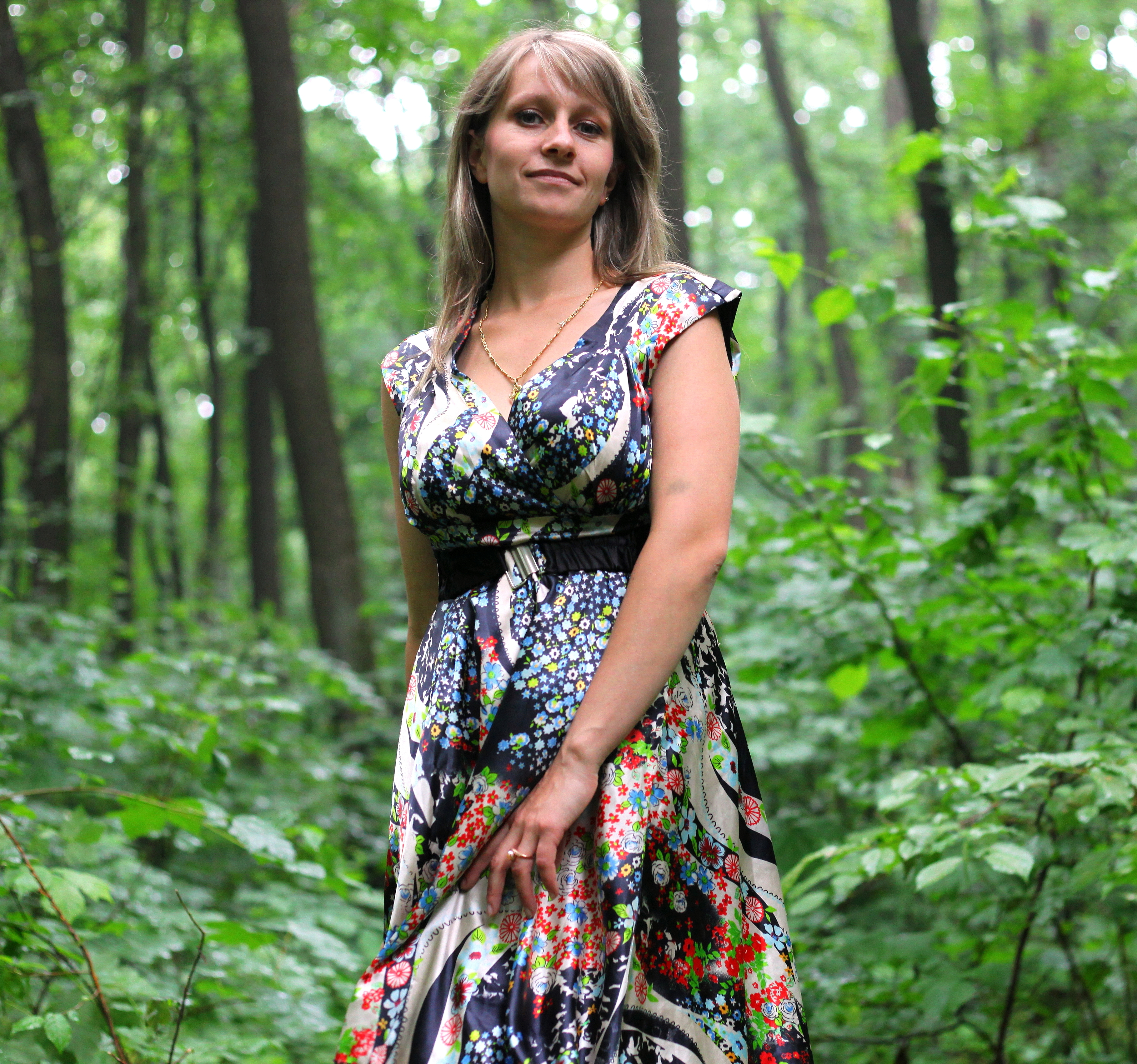 a young Catholic woman wearing a colorful dress in a forest in June 2013, portrait 8/9