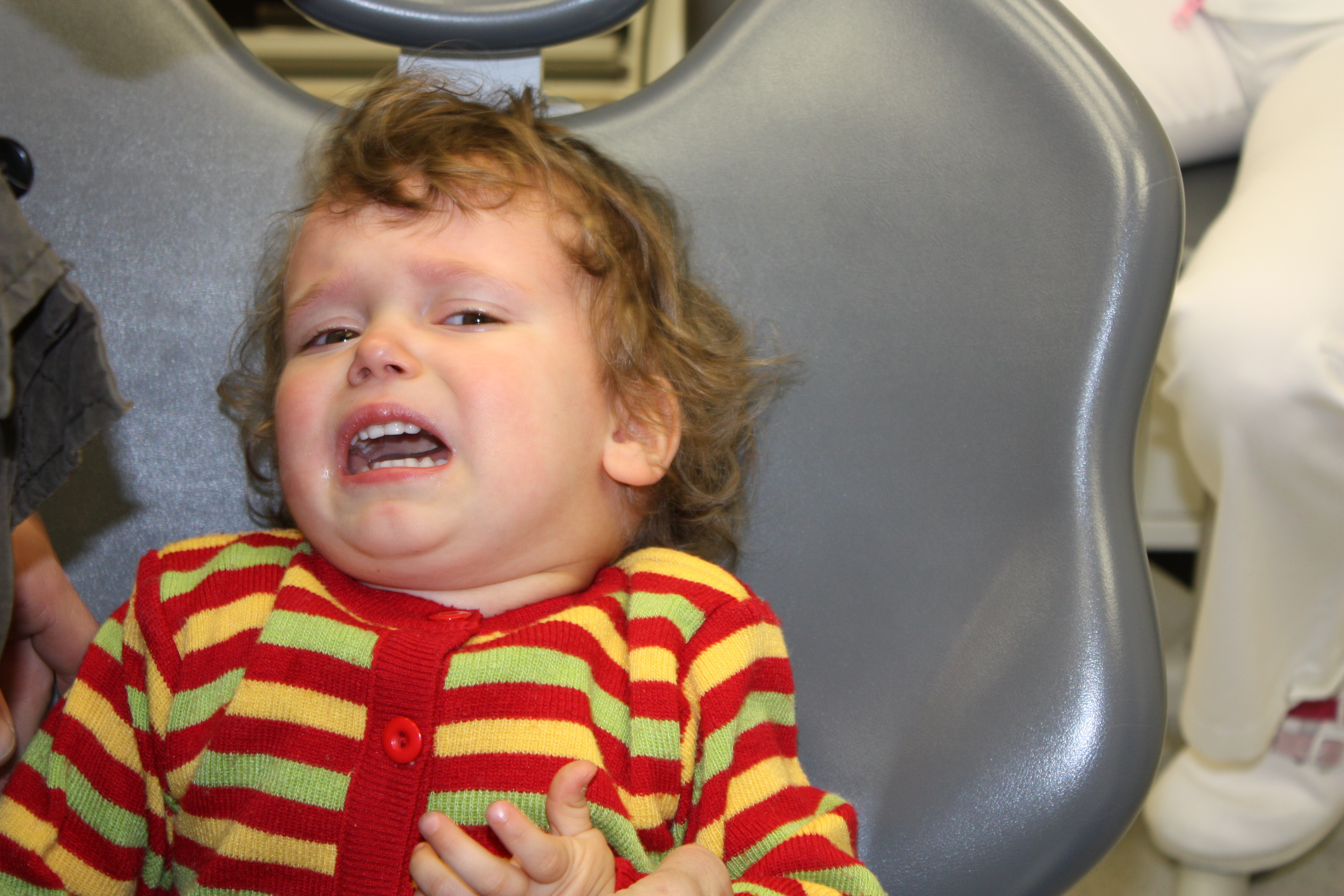Angry child at dental treatment