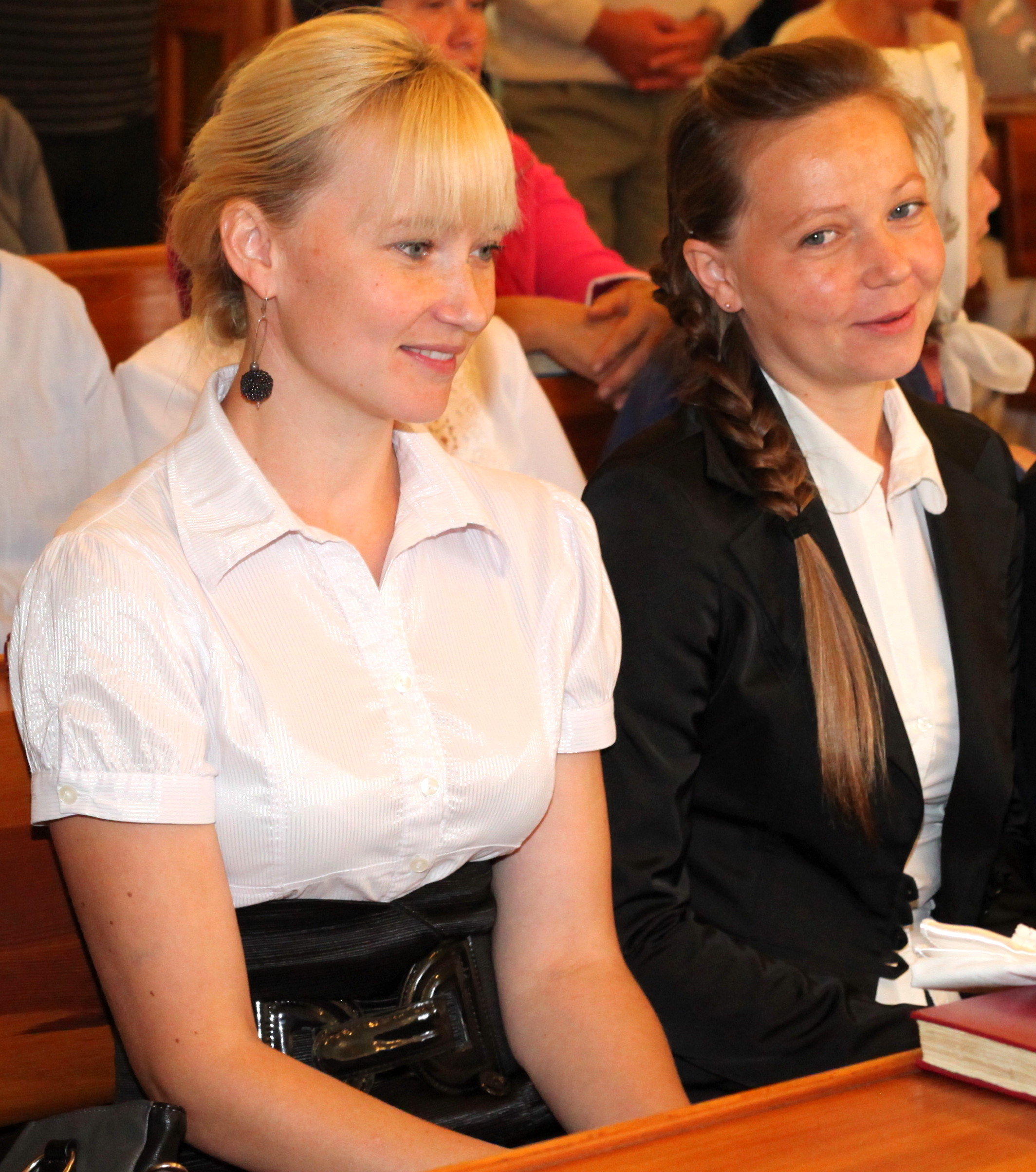 godmother (left) and mother at the baptism of a baby boy in the Catholic Church, picture 14