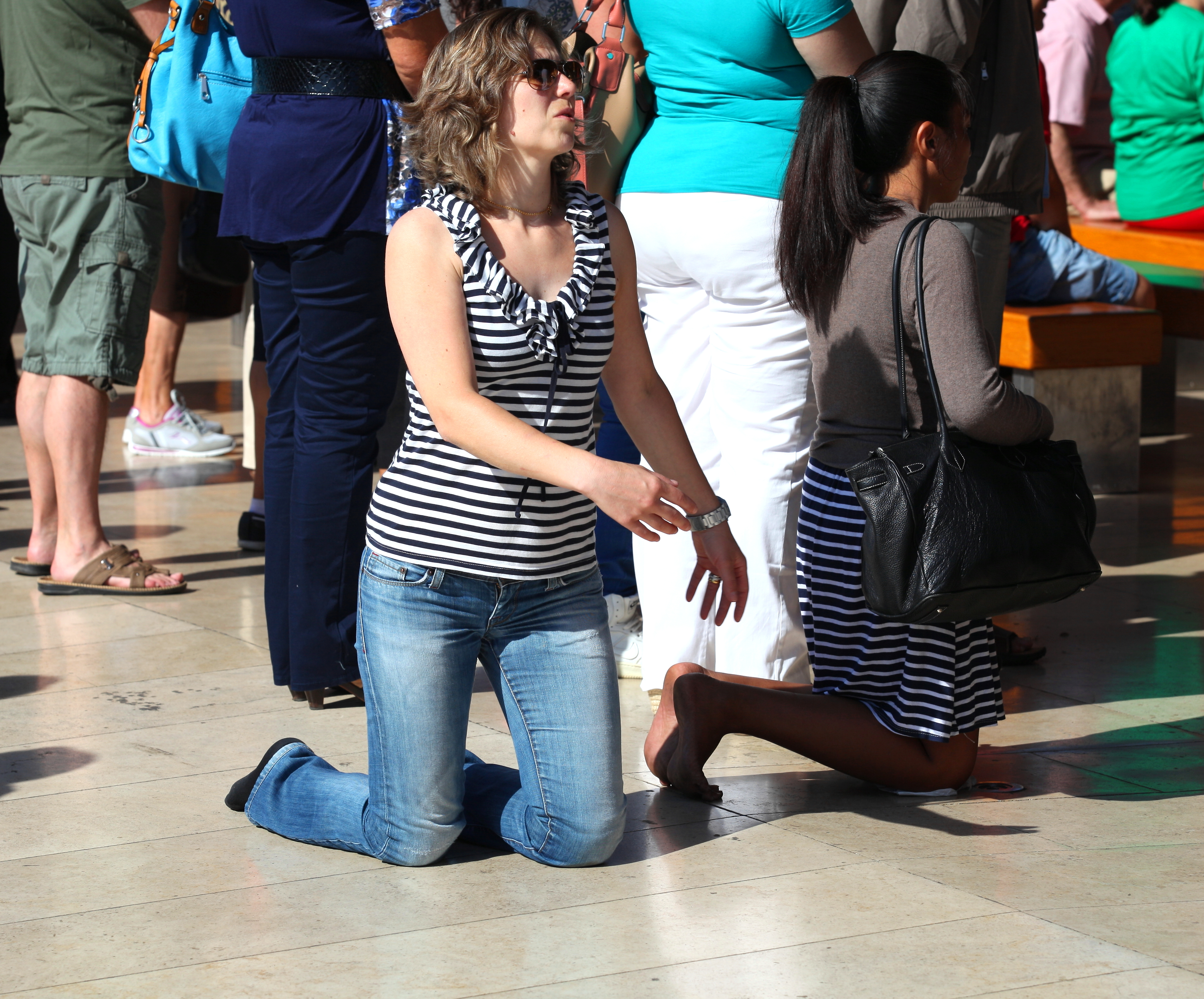 a woman walking on her knees in Fatima, Portugal, Europe, August 2013, picture 11