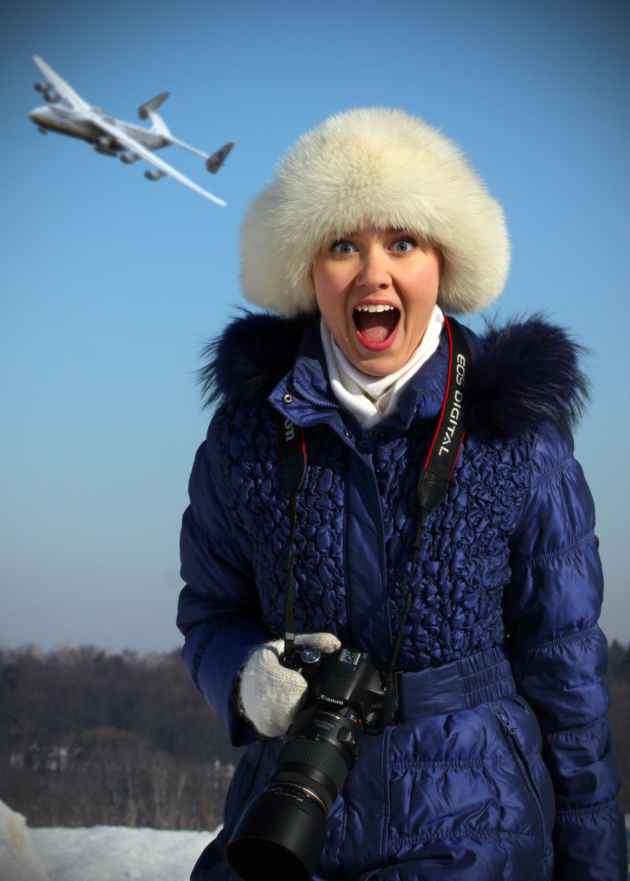Female Russian photographer with the Antonov An-225 overhead