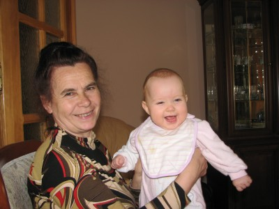 Grandmom with her baby grand daughter, smiling. Family. Picture 2.