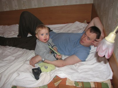 Father with his baby daughter on a bed