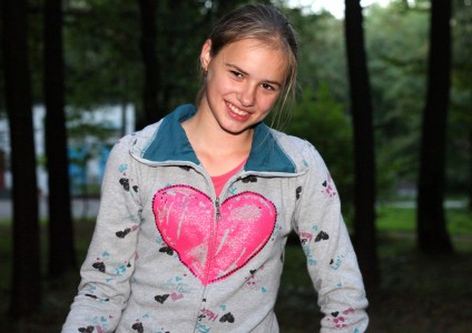 a beautiful appealing smiling Catholic girl in a park, picture 19