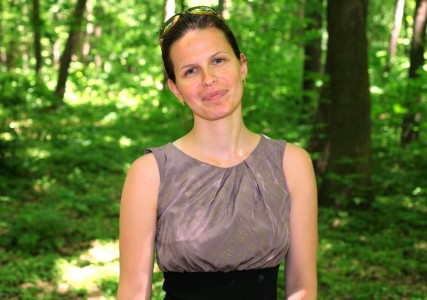 a beautiful brunette Catholic woman in a forest in May 2013, portrait 3/4