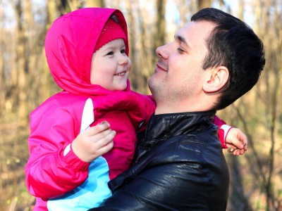 a handsome Catholic father with his cute daughter in a forest, picture 2